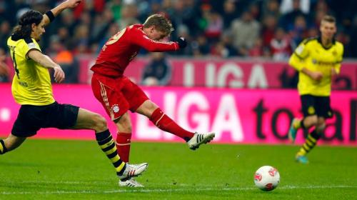 Kroos of Bayern Munich sores a goal against Borussia Dortmund during their German first division Bundesliga soccer match in Munich